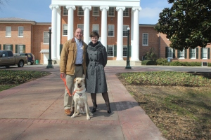 A portrait photo of Finn with Dave and Brandi Hephner LaBanc in the Circle with the Ole Miss Lyceum in the background.